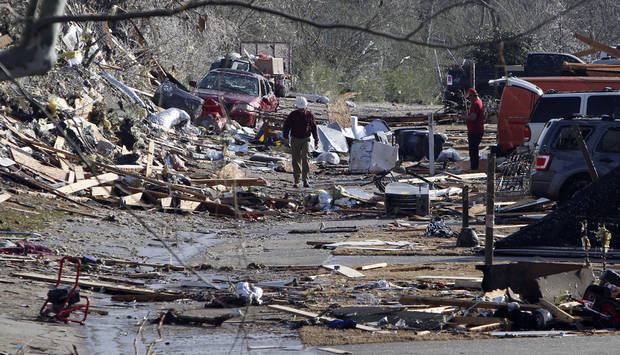 Residents comb through debris looking for personal belongings after a severe storm and possible tornado ripped through the Georgebrook subdivision area  in Trussville, Ala. in the early hours of Monday, Jan. 23, 2012.  (AP Photo/Butch Dill) ORG XMIT: ALBD116