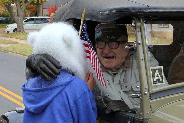 Courtney Meyer greets her great, great grandfather Frank Harmon,World War II veteran during the Veterans Day parade in Norman Sunday. PHOTO BY HUGH SCOTT FOR THE OKLAHOMAN ORG XMIT: KOD