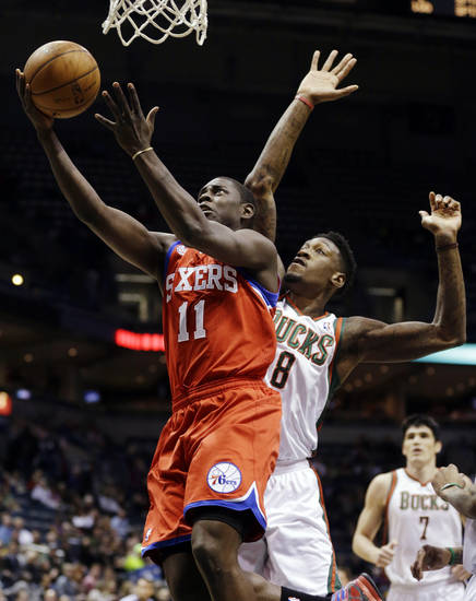 Philadelphia 76ers' Jrue Holiday (11) shoots against Milwaukee Bucks' Larry Sanders (8) during the first half of an NBA basketball game, Tuesday, Jan. 22, 2013, in Milwaukee. (AP Photo/Jeffrey Phelps)