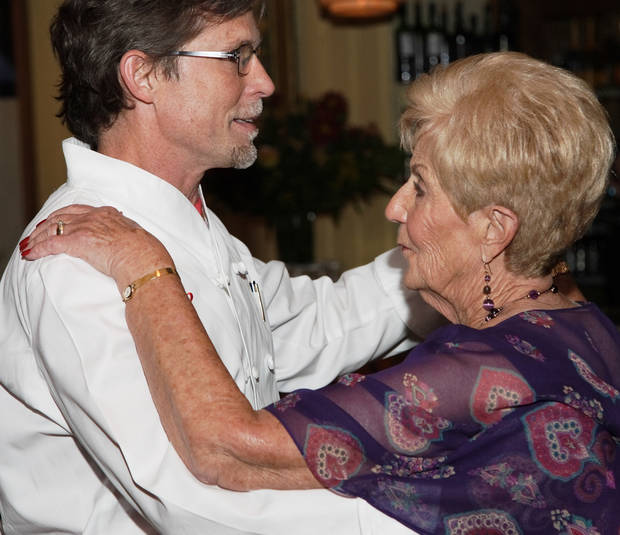 Rick Bayless dances with his mother Levita Anderson during her 80th birthday party.