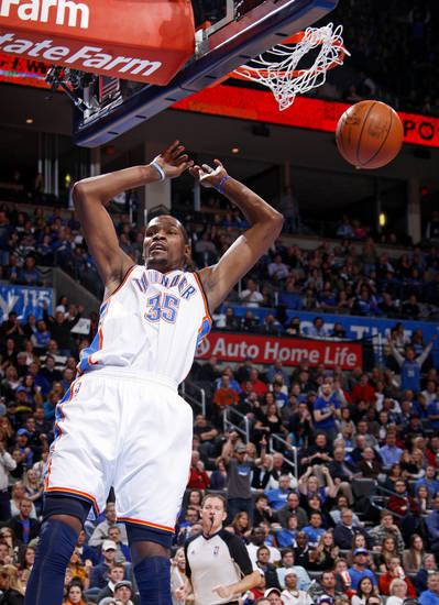 Oklahoma City's Kevin Durant (35) dunks the ball during the NBA game between the Oklahoma City Thunder and the New York Knicks at Chesapeake Energy Arena in Oklahoma CIty, Saturday, Jan. 14, 2012. Photo by Bryan Terry, The Oklahoman
