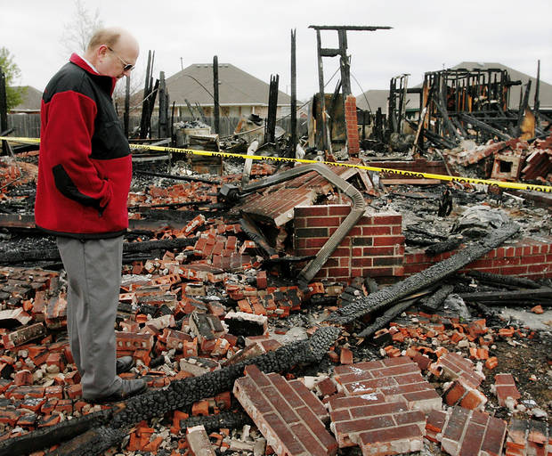 Floyd Craft  pauses in front of all that remains of his home at 1143 Village   in Oakwood East Royale neighborhood. The house was reduced to ashes and rubble, but in a twist of irony, his outdoor storage shed was spared. Photo by Jim Beckel, The Oklahoman
