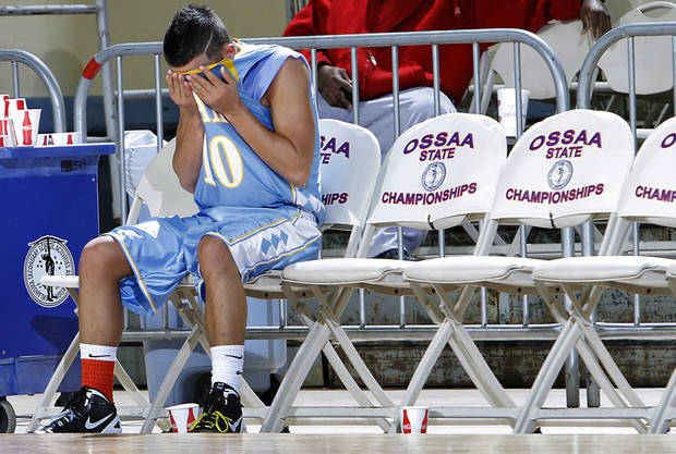 Oktaha's Blake Pittman sits a the end of the bench in the final seconds of the loss during the first round 2A boys State Basketball Championship game between Northeast High School and Oktaha High School at the State Fair Arena on Thursday, March 8, 2012 in Oklahoma City, Okla.  Photo by Chris Landsberger, The Oklahoman