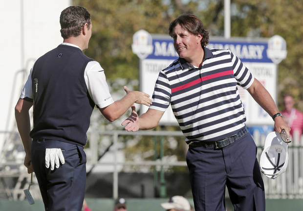 USA's Phil Mickelson, right, congratulates Europe's Justin Rose after a singles match at the Ryder Cup PGA golf tournament Sunday, Sept. 30, 2012, at the Medinah Country Club in Medinah, Ill. (AP Photo/Charlie Riedel)  ORG XMIT: PGA167