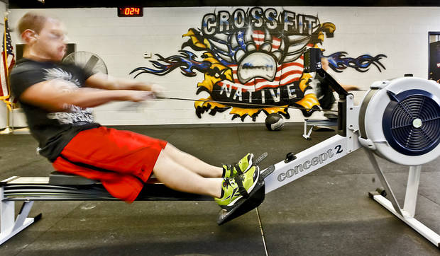 Michael Dugan is a blur of motion as he  works on the rowing exercise at Crossfit Native <strong>CHRIS LANDSBERGER - CHRIS LANDSBERGER</strong>