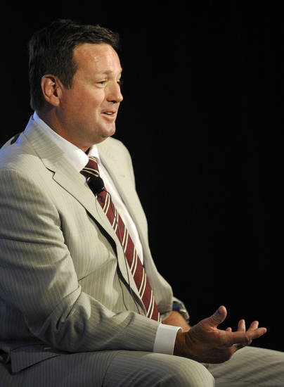 Oklahoma head coach Bob Stoops answers questions at NCAA college football Big 12 Media Days, Monday, July 23, 2012, in Dallas. (AP Photo/Matt Strasen)