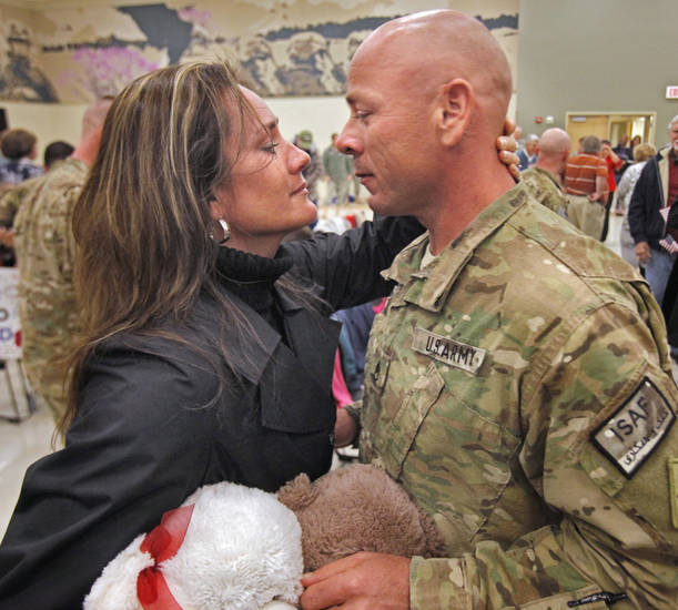 Sgt. William Noland, Noble, is greeted by his wife Anja as families celebrate the homecoming of 40 members of the 45th Infantry returning from Afghanistan on Saturday, Feb. 11, 2012, in Norman, Okla.  Photo by Steve Sisney, The Oklahoman