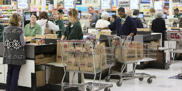 Full carts at the check out lanes at Crest Foods in Edmond Monday, Feb. 7, 2011. Photo by Paul B. Southerland, The Oklahoman