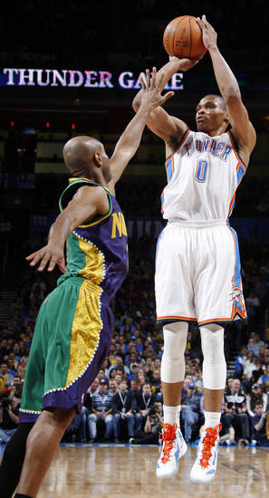 Oklahoma City's Russell Westbrook (0) shoots over New Orleans' Jarrett Jack (2) during an NBA basketball game between the Oklahoma City Thunder and the New Orleans Hornets at the Chesapeake Energy Arena in Oklahoma City, Monday, Feb. 20, 2012. Photo by Nate Billings, The Oklahoman