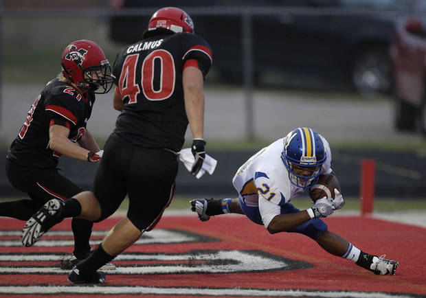 Stillwater's Davyn Thompson (21) goes down for a safety during a high school football game between Mustang and Stillwater in Mustang, Okla., Friday, Sept. 14, 2012.  Photo by Garett Fisbeck, The Oklahoman