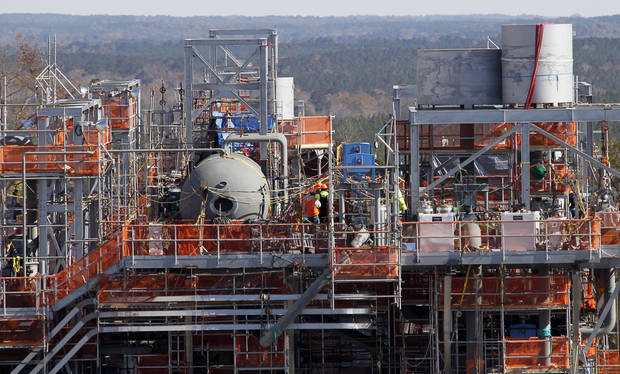 In this Nov. 13, 2012 photograph, workmen secure a steam drum on top of the heat recovery steam generator on the combine cycle at Mississippi Power's Kemper County energy facility near DeKalb, Miss. The plant, still under construction, is designed to use a soft form of coal called lignite in a gasification process to generate power. The project has come under legal challenge by the Mississippi Sierra Club. The environmental organization says the gasification technology is expensive and unproven. (AP Photo/Rogelio V. Solis)
