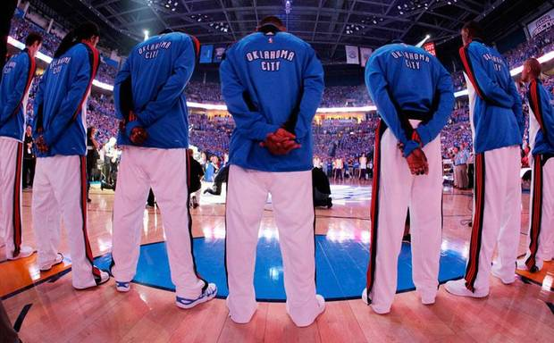 The Oklahoma City Thunder stand for the National Anthem before the basketball game between the Los Angeles Lakers and the Oklahoma City Thunder in the first round of the NBA playoffs at the Ford Center in Oklahoma City, Thursday, April 22, 2010. Photo by Nate Billings, The Oklahoman
