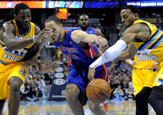 Denver Nuggets guard Andre Iguodala, right, steals the ball from Detroit Pistons forward Tayshaun Prince (22) as Nuggets forward Kenneth Faried, left, looks on during the first quarter of an NBA basketball game, Tuesday, Nov. 6, 2012, in Denver. (AP Photo/Jack Dempsey)