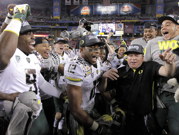 Oregon players celebrate at mid field after the Fiesta Bowl NCAA college football game, Thursday, Jan. 3, 2013, in Glendale, Ariz. Oregon won 35-17.(AP Photo/Matt York)