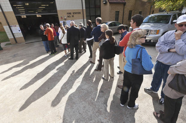 Voters wait in line outside a fire station being used as a polling place in Little Rock, Ark., Tuesday, Nov. 6, 2012. (AP Photo/Danny Johnston)