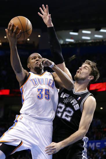 Oklahoma City's Kevin Durant (35) shoots over San Antonio's Tiago Splitter (22) during the NBA game between the Oklahoma City Thunder and the San Antonio Spurs at the Chesapeake Energy Arena, Thursday, April 4, 2013. Photo by Sarah Phipps, The Oklahoman