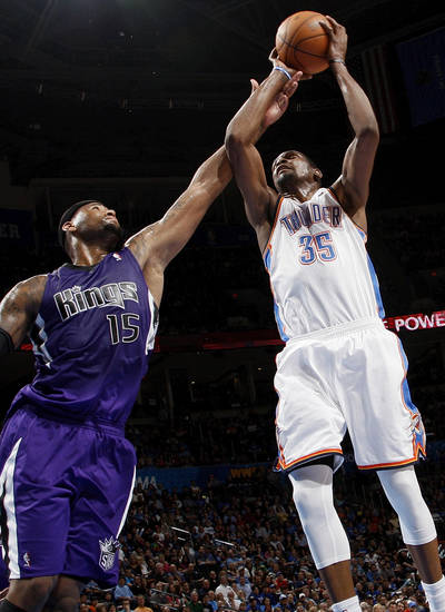 Oklahoma City's Kevin Durant (35) grabs a rebound next to Sacramento's DeMarcus Cousins (15) during the NBA basketball game between the Oklahoma City Thunder and the Sacramento Kings at Chesapeake Energy Arena in Oklahoma City, Friday, April 13, 2012. Oklahoma City won, 115-89. Photo by Nate Billings, The Oklahoman
