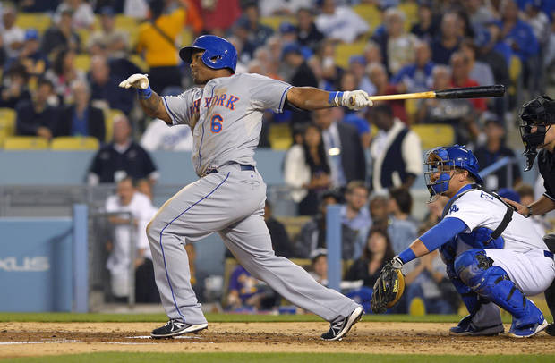 New York Mets' Marlon Byrd watches his three-run home run in front of Los Angeles Dodgers catcher Tim Federowicz during the third inning of a baseball game, Wednesday, Aug. 14, 2013, in Los Angeles. (AP Photo/Mark J. Terrill)