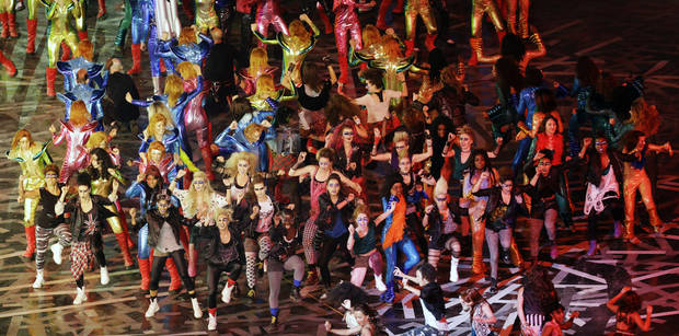Actors perform during the Opening Ceremony at the 2012 Summer Olympics, Friday, July 27, 2012, in London. (AP Photo/Lee Jin-man) ORG XMIT: OLY