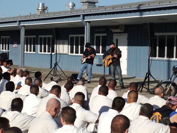 Contemporary Christian recording artist Matthew Blagg performs in front of inmates in a prison yard as part of a Bill Glass Weekend of Champions event. Photo provided <strong></strong>