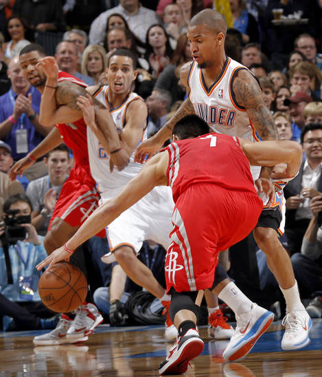 Oklahoma City &#039;s Eric Maynor (6) defends on Houston&#039;s Jeremy Lin (7) during the NBA basketball game between the Houston Rockets and the Oklahoma City Thunder at the Chesapeake Energy Arena on Wednesday, Nov. 28, 2012, in Oklahoma City, Okla.   Photo by Chris Landsberger, The Oklahoman