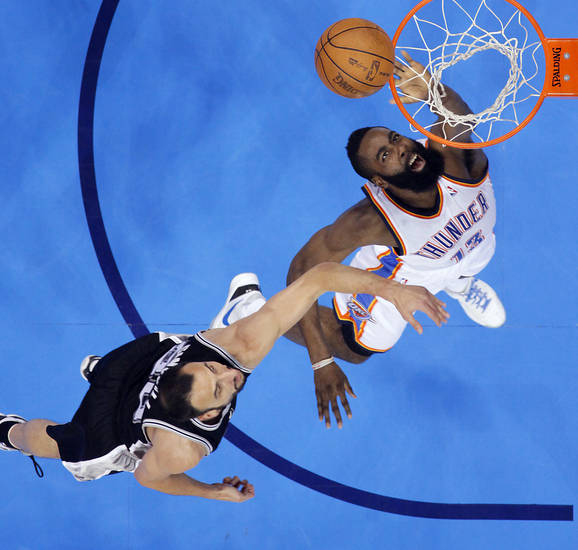 Oklahoma City's James Harden (13) drives to the basket past San Antonio's Manu Ginobili (20) during Game 6 of the Western Conference Finals between the Oklahoma City Thunder and the San Antonio Spurs in the NBA playoffs at the Chesapeake Energy Arena in Oklahoma City, Wednesday, June 6, 2012. Photo by Chris Landsberger, The Oklahoman