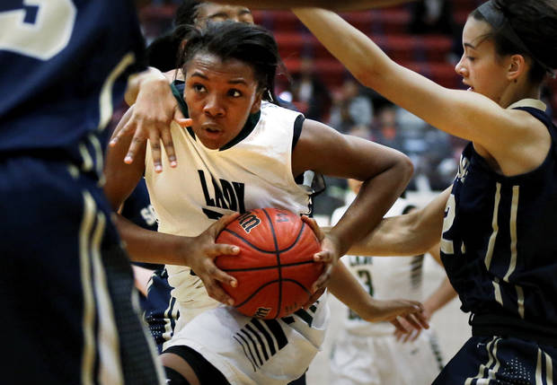 Muskogee's Aaliyah Wilson drives past Southmoore's Kayla Tucker, right, in the girls championship of the John Nobles Invitational Tournament on Saturday, Jan. 26, 2013  in Moore, Okla. Photo by Steve Sisney, The Oklahoman