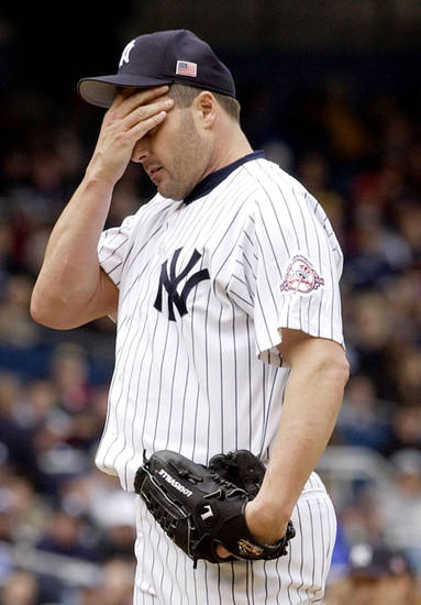FILE - This May 26, 2003 file photo shows New York Yankees starter Roger Clemens reacting on the mound during the third inning of a baseball game against the Boston Red Sox in New York. With the cloud of steroids shrouding many candidacies, baseball writers may fail for the only the second time in more than four decades to elect anyone to the Hall, Wednesday, Jan. 9, 2013. (AP Photo/Kathy Willens, File)