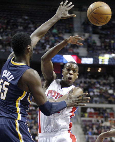 Detroit Pistons forward Khris Middleton, right, passes the ball against the defense from Indiana Pacers center Roy Hibbert (55) in the first half of an NBA basketball game Saturday, Feb. 23, 2013, in Auburn Hills, Mich. (AP Photo/Duane Burleson)