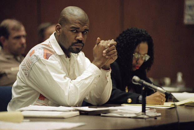 FILE - This Feb. 4, 1993 file photo shows Henry Watson, one of three men accused of beating truck driver Reginald Denny, during his trial in a Los Angeles courtroom. At right is his lawyer Karen Ackerson. The acquittal of four police officers in the videotaped beating of Rodney King sparked rioting that spread across the city and into neighboring suburbs. Cars were demolished and homes and businesses were burned. Before order was restored, 55 people were dead, 2,300 injured and more than 1,500 buildings were damaged or destroyed.((AP Photo/Nick Ut, File)