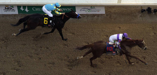Jockey Mario Gutierrez rides I'll Have Another past Bodemeister ridden by Mike Smith (6) to victory in the 138th Kentucky Derby horse race at Churchill Downs Saturday, May 5, 2012, in Louisville, Ky. (AP Photo/Charlie Riedel)  ORG XMIT: DBY209