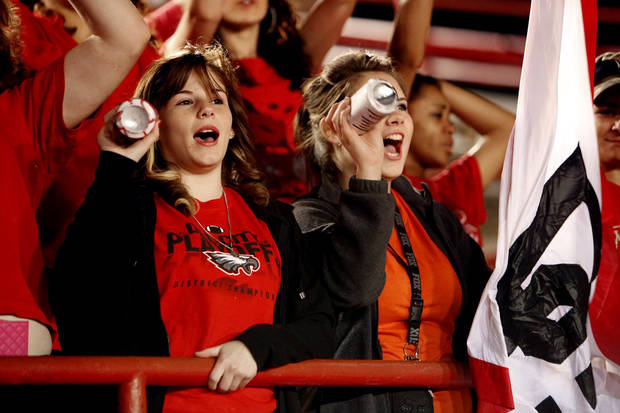 Del City fans Kaytoyn Newton and Morgan Lawson cheer as their team plays the Carl Albert Titans iClass 5A, first round, playoff action in high school football on Friday, Nov. 9, 2012 in Del City, Okla.   Photo by Steve Sisney, The Oklahoman