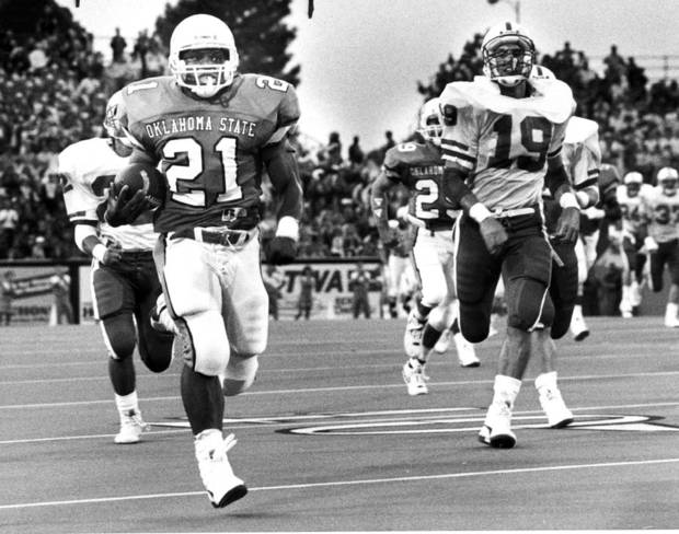 OKLAHOMA STATE UNIVERSITY / COWBOYS FOOTBALL / OSU: Barry Sanders 89 yard TD, outruns the Miami of Ohio defense. Staff Photo by Doug Hoke