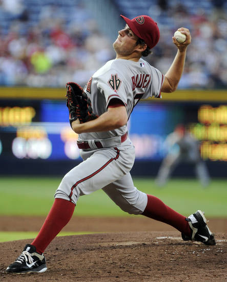 FILE - In this June 28, 2012, file photo, Arizona Diamondbacks' Trevor Bauer pitches against the Atlanta Braves during the third inning of a baseball game in Atlanta. The Cleveland Indians traded outfielder Shin-Soo Choo to the Cincinnati Reds and acquired Bauer in a three-team deal Tuesday, Dec. 11. (AP Photo/John Amis, File)
