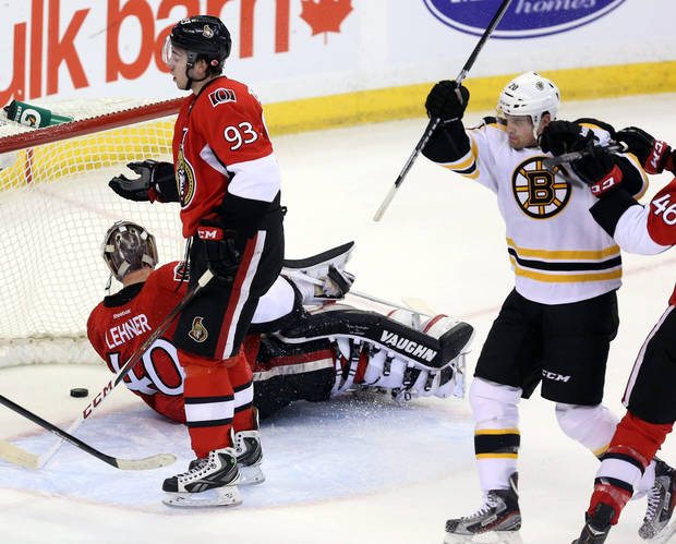 Boston Bruins' Daniel Paille (20) celebrates his goal as Ottawa Senators goaltender Robin Lehner (40) and Mika Zibanejad (93) look on during the second period of their NHL hockey game, Thursday, March 21, 2013, in Ottawa, Ontario. (AP Photo/The Canadian Press, Fred Chartrand)