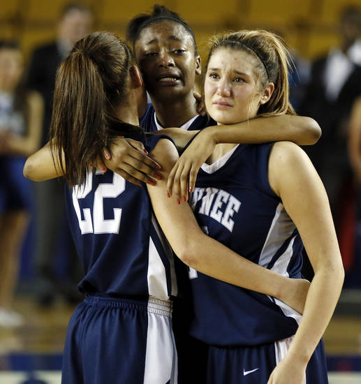 From left, Shawnee's Shaiann Tramble (22), Monique Tramble (33) and Bailey Taylor (20) react after losing the Class 5A girls championship high school basketball game in the state tournament at the Mabee Center in Tulsa, Okla., Saturday, March 9, 2013. Deer Creek defeated Shawnee, 59-44. Photo by Nate Billings, The Oklahoman