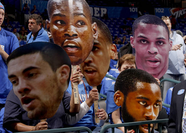 Fans hold cardboard cutouts of Thunder players before game two of the Western Conference semifinals between the Memphis Grizzlies and the Oklahoma City Thunder in the NBA basketball playoffs at Oklahoma City Arena in Oklahoma City, Tuesday, May 3, 2011. Photo by Bryan Terry, The Oklahoman