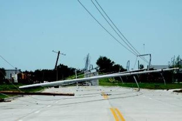 Power lines down on Radio Road near Performance Technologies, just south of Interstate 40. The new PT building was also damaged in the May 31 tornado. Traci Chapman