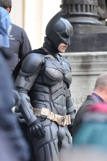 "Actor Christian Bale works on the set of the latest Batman film, ""The Dark Knight Rises"" on Wall Street in New York on Sunday Nov. 6, 2011. (AP Photo/Darla Khazei) <strong></strong>"