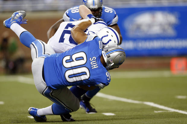 Detroit Lions defensive tackle Ndamukong Suh (90) sacks Indianapolis Colts quarterback Andrew Luck (12) in the first quarter of an NFL football game at Ford Field in Detroit, Sunday, Dec. 2, 2012. (AP Photo/Rick Osentoski)