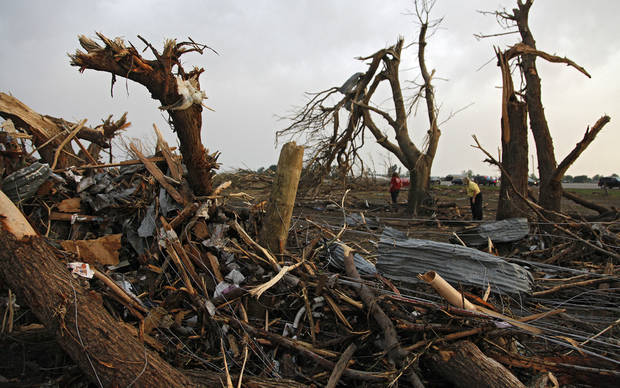 Splinter trees in the yard of Tom Chronister's home after being destroyed north of El Reno, Tuesday, May 24, 2011. Photo by Chris Landsberger, The Oklahoman ORG XMIT: KOD