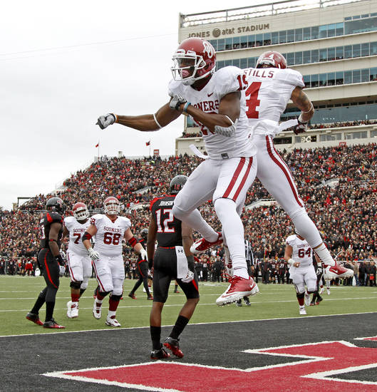 Oklahoma's Justin Brown (19) celebrates with Kenny Stills (4) after Brown scored a touchdown during a college football game between the University of Oklahoma (OU) and Texas Tech University at Jones AT&T Stadium in Lubbock, Texas, Saturday, Oct. 6, 2012. Photo by Bryan Terry, The Oklahoman