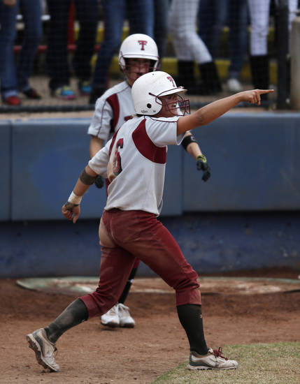 Tuttle's Shelby Carel (6) celebrates after scoring a run during the 4A state softball semifinals game between Oolagah-Talala and Tuttle at ASA Hall of Fame Stadium in Oklahoma City, Okla., Friday, Oct. 12, 2012.  Photo by Garett Fisbeck, The Oklahoman