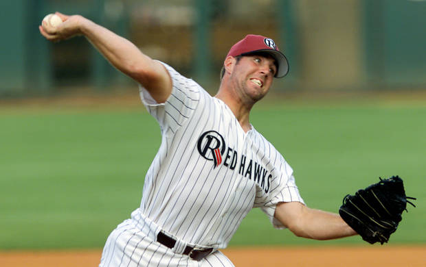 Oklahoma RedHawks baseball pitcher R.A. Dickey delivers a pitch during their game with Calgary. Staff Photo By Steve Gooch