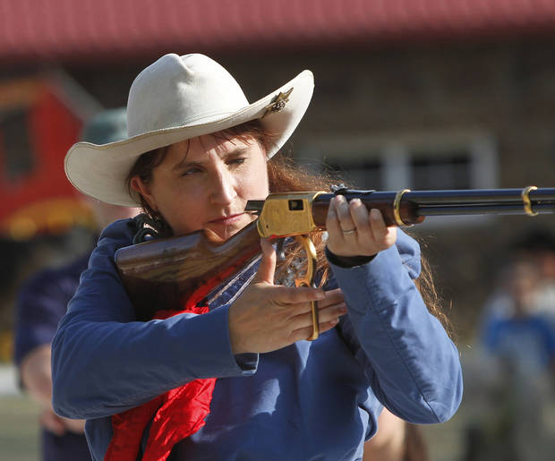 Marna Davis portrays  Old West sharpshooter and trick shot expert Annie Oakley. She and her husband, Doug,  who,plays the role of Oakley's husband and partner, Frank Butler, are from Hitchcock, Oklahoma.   The Davis'  are part of free entertainment for visitors to the Pawnee Bill Ranch and Museum during the afternoon on performance dates.  Historically accurate accurate entertainment is free and takes place on grounds of the museum and mansion before the  Pawnee Bill Wild West Show starts.  Photo taken  Saturday,  June 23, 2012.  Photo by Jim Beckel, The Oklahoman