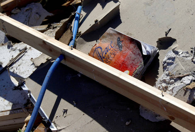 A book rests in the debris of an office building in Woodward, Okla., Sunday, April 15, 2012. A tornado that killed five people struck Woodward, Okla., shortly after midnight on Sunday, April15, 2012.  Photo by Bryan Terry
