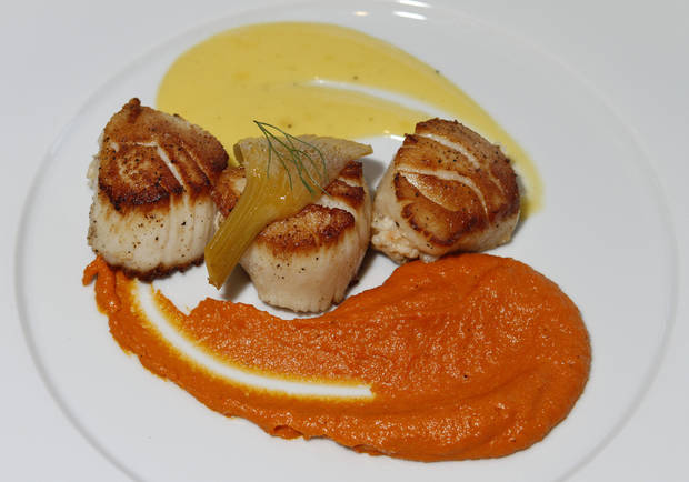 These lobster-stuffed seared scallops are served with cardamom-infused carrot puree, passion fruit reduction and citrus-braised fennel are on the menu at Vast. Photo by Steve Gooch, The Oklahoman <strong>Steve Gooch - The Oklahoman</strong>