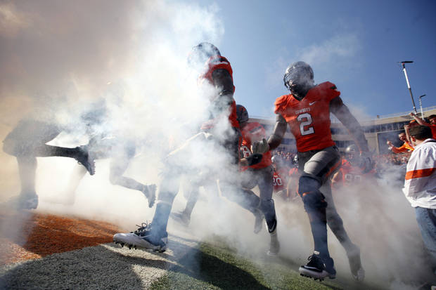 Oklahoma State's Lavocheya Cooper (2) runs on to the field before a college football game between the Oklahoma State University Cowboys (OSU) and the Baylor University Bears (BU) at Boone Pickens Stadium in Stillwater, Okla., Saturday, Oct. 29, 2011. Photo by Sarah Phipps, The Oklahoman