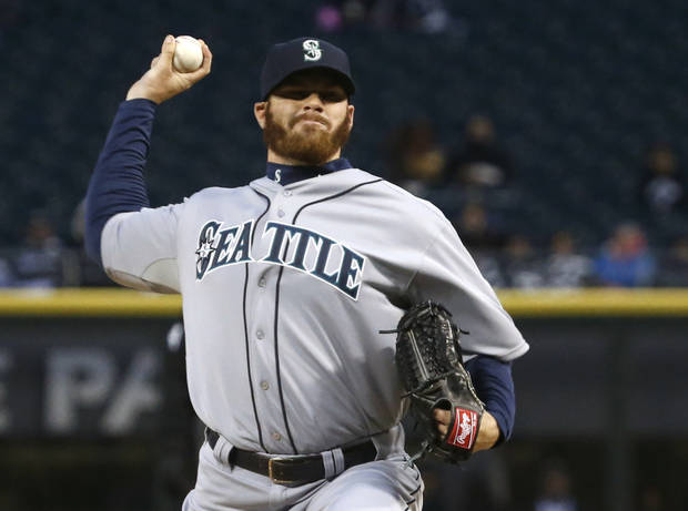 Seattle Mariners starting pitcher Blake Beavan delivers during the first inning of a baseball game against the Chicago White Sox, Friday, April 5, 2013, in Chicago. (AP Photo/Charles Rex Arbogast)