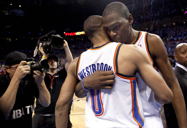 Oklahoma City's Kevin Durant (35) and Russell Westbrook (0) celebrate their win in the first round in the NBA playoffs between the Oklahoma City Thunder and the Dallas Mavericks at Chesapeake Energy Arena in Oklahoma City, Saturday, April 28, 2012. Photo by Sarah Phipps, The Oklahoman